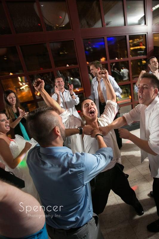 groom partying at wedding reception at st clair ballroom