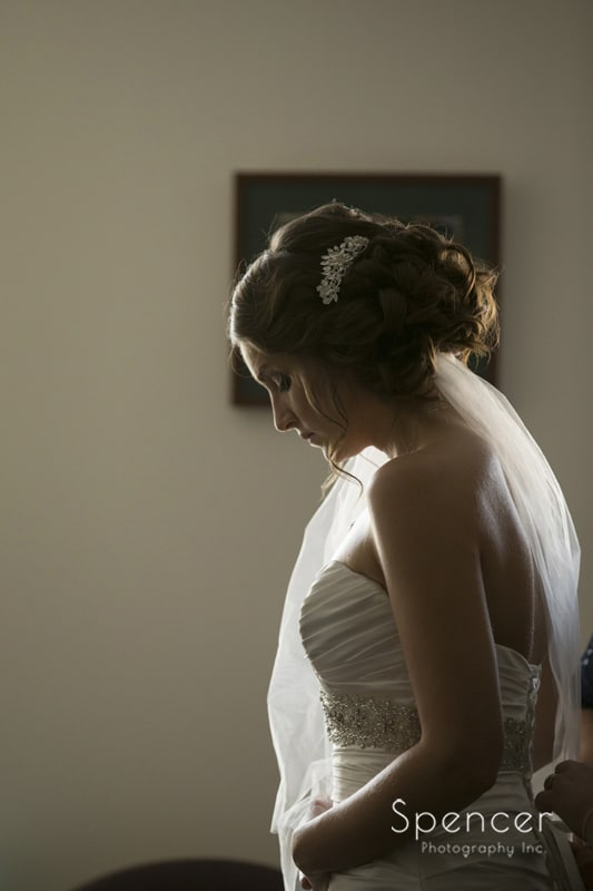 bride putting on her wedding dress in Canton
