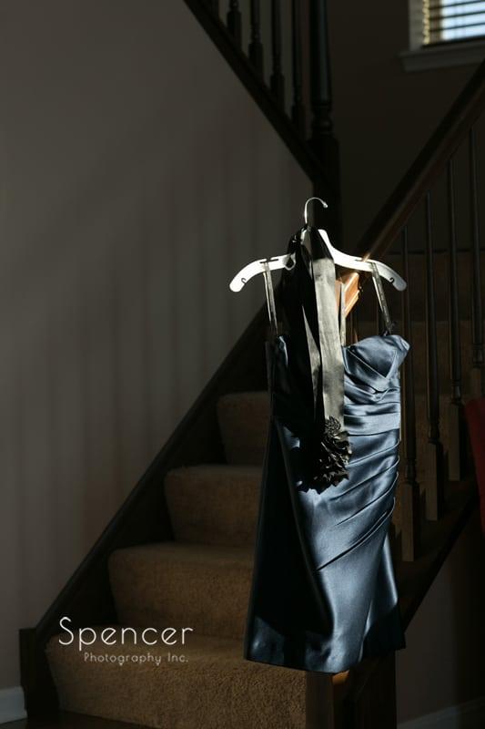 bridesmaids dress hanging in sunlight