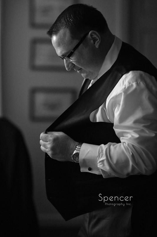 groom getting dress for wedding at church in Chagrin Falls