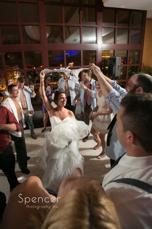 bride partying at her wedding reception at st clair ballroom