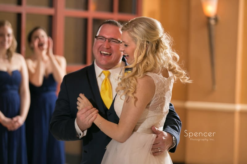 bride and groom laughing during their first dance