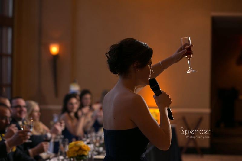 maid of honor raised toast at wedding reception at St. Clair Ballroom Cleveland