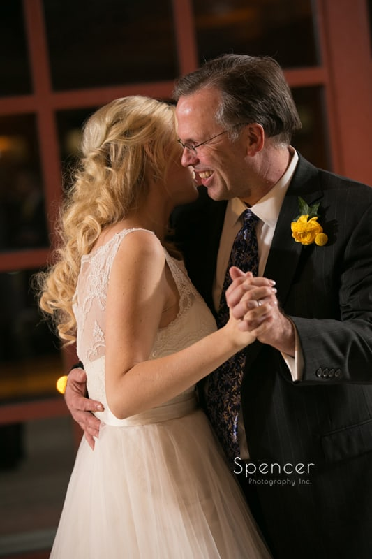 bride dancing with her stepfather
