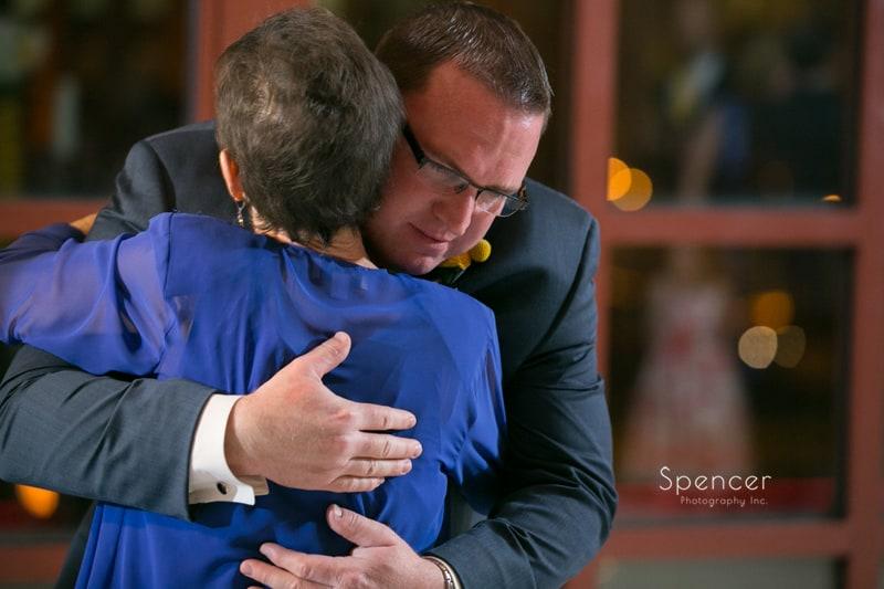 groom hugging his mom