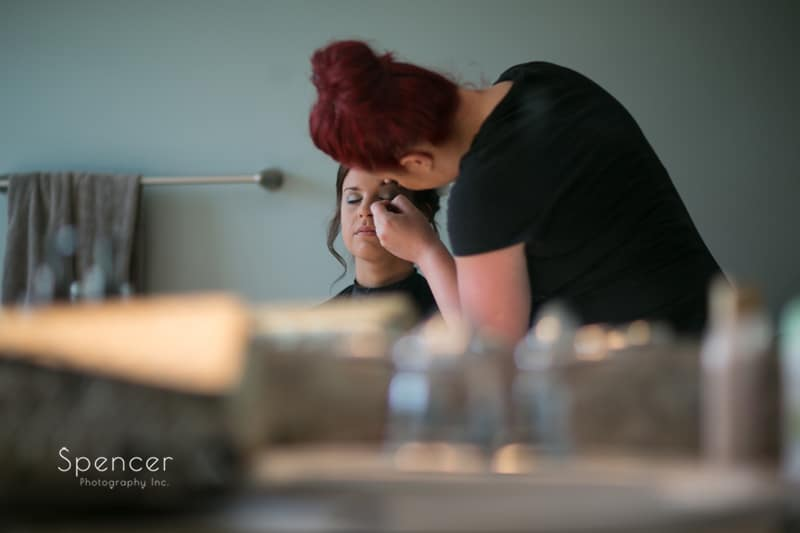 bride getting make-up in strongsville