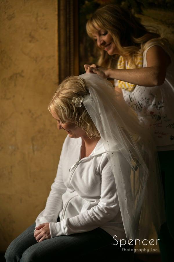 bride getting veil before her wedding at Gervasi Vinyard