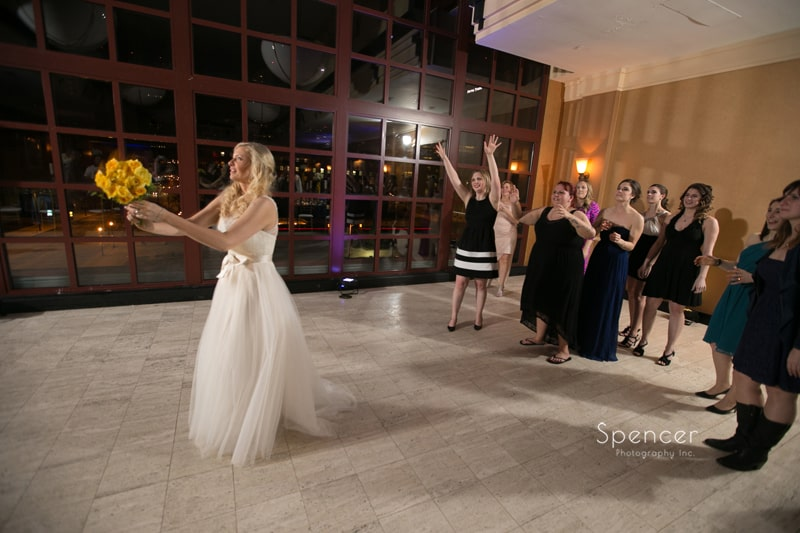 bride throwing her bouquet at wedding reception at St. Clair Ballroom Cleveland