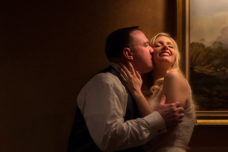 groom kissing bride after their wedding reception at St. Clair Ballroom Cleveland