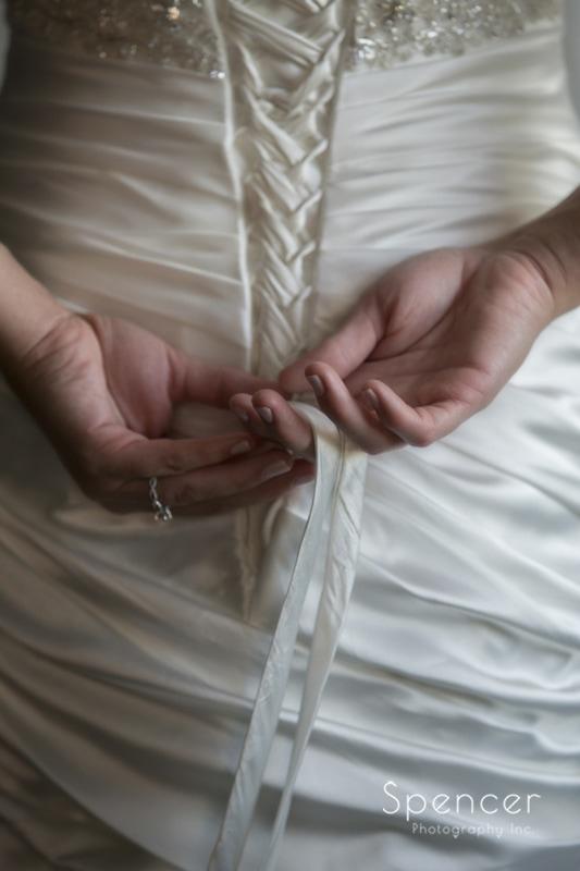 detail of brides wedding dress
