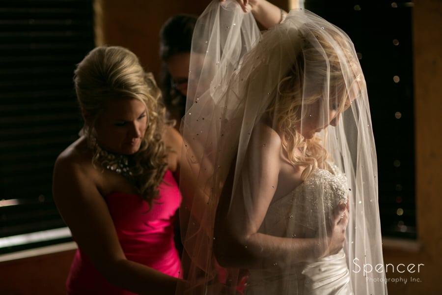adjusting wedding dress in suite at Gervasi wedding
