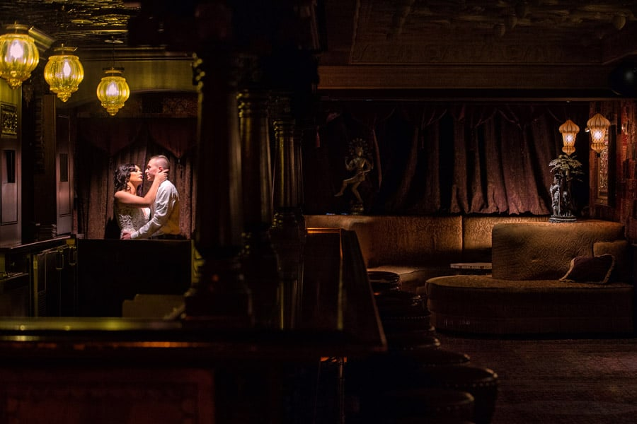 bride and groom kissing in foundation room at House of Blues Cleveland