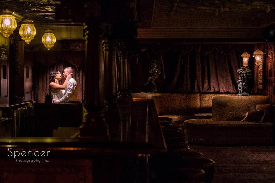 bride and groom kissing in foundation room of house of blues cleveland