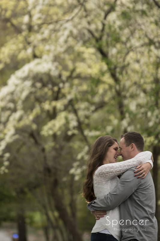 couple kissing in their engagement photo at Wade Oval Park in Cleveland