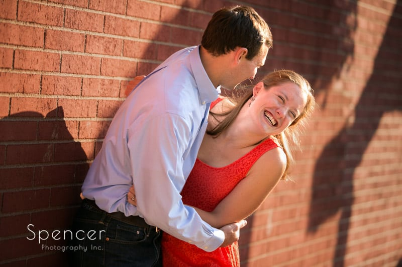 couple laughing hysterically for their engagement pictures in Cleveland