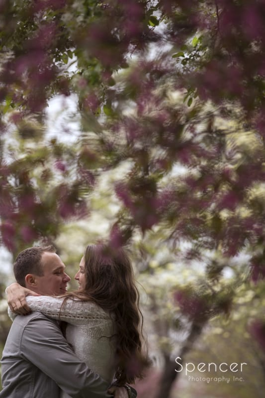 engagement picture with flowers in Wade Oval Park