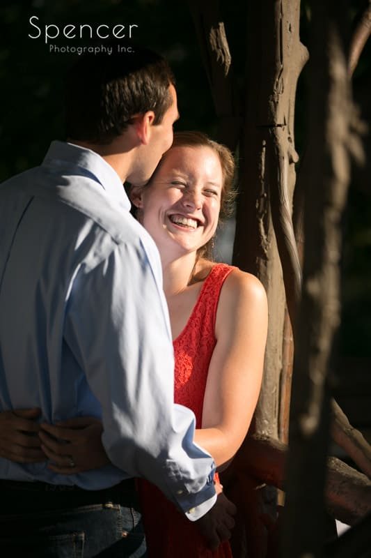 woman laughing during her engagement photography in Cleveland