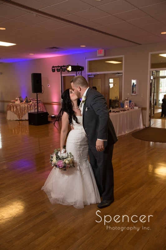 bride and groom kissing at their wedding reception in Perry Ohio