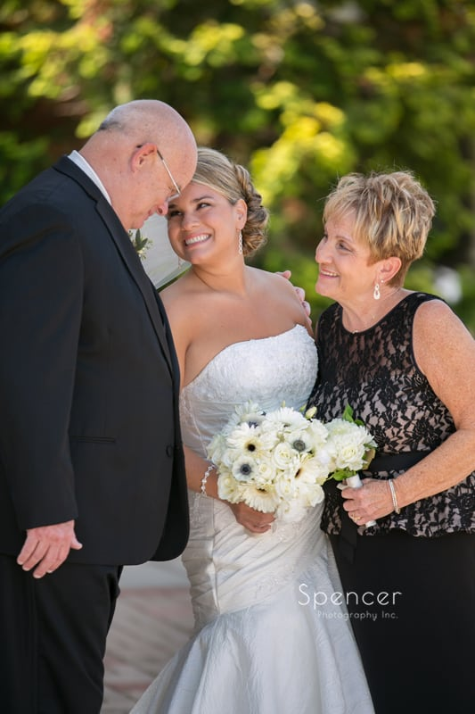 brides parents hugging bride