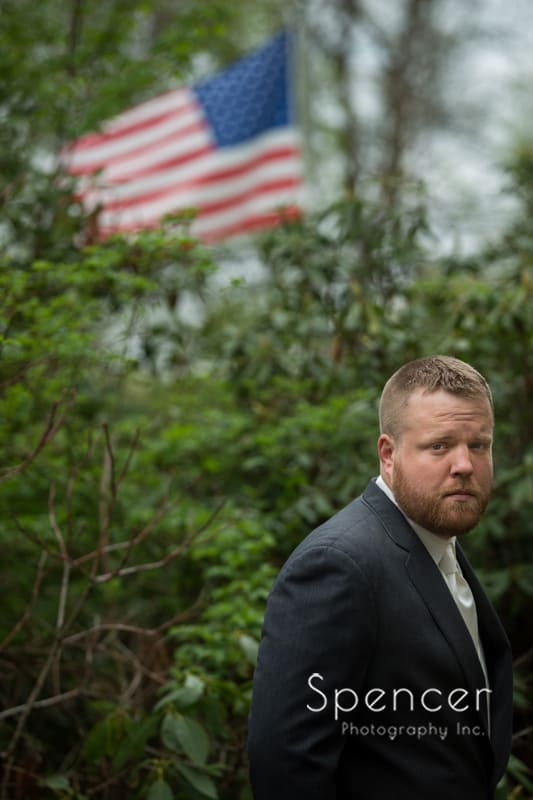 wedding day portrait of groom with american flag