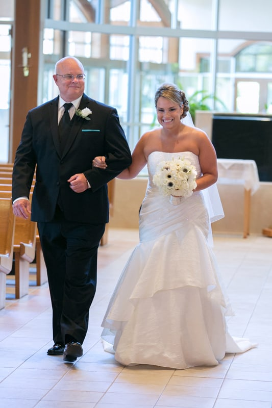 bride walking down aisle at Mentor wedding ceremony