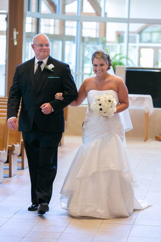 bride walking down aisle at Mentor wedding ceremony