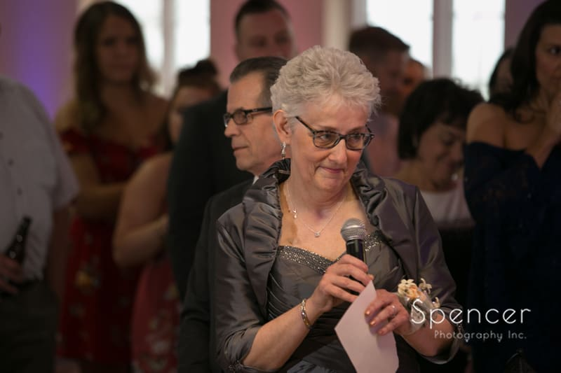mother of the bride giving speech at wedding reception