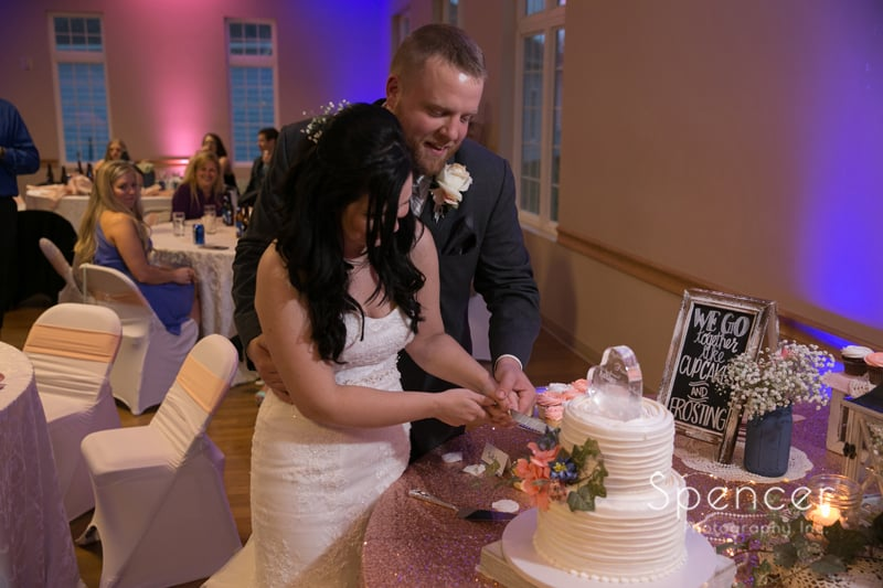bride and groom cutting their wedding cake at Perry reception