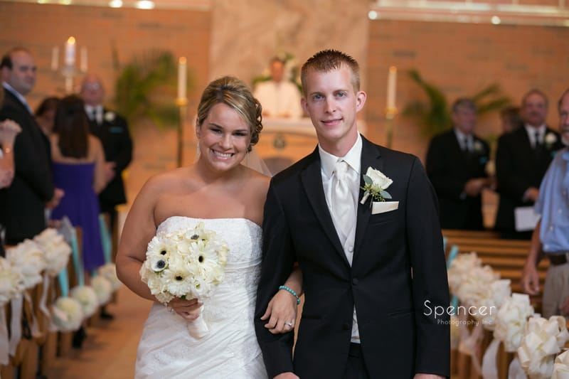 bride and groom smiling at camera after their wedding