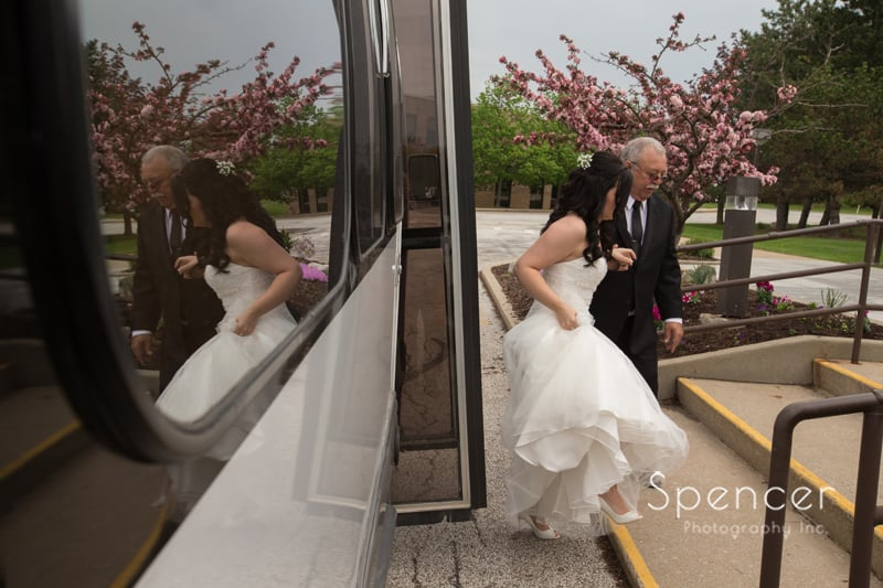 bride getting out of limo heading towards her wedding day in Mentor