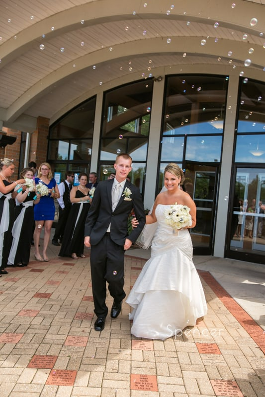 bride and groom exiting their wedding ceremony in Cleveland