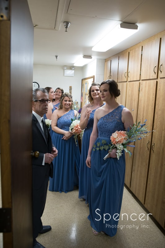 bridesmaids waiting for wedding in Mentor to start