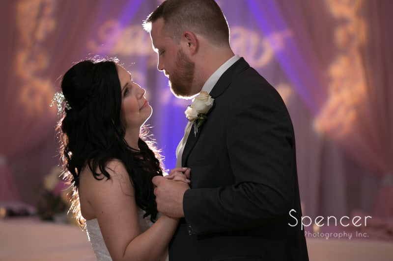 close up wedding picture of bride and groom first dance