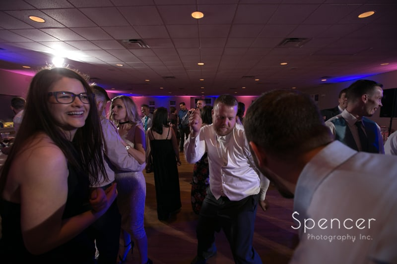groom dancing at his wedding reception at Perry Community Center