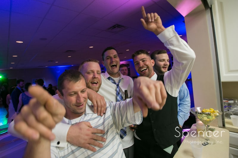 groom having fun at his wedding reception at Perry Community Center