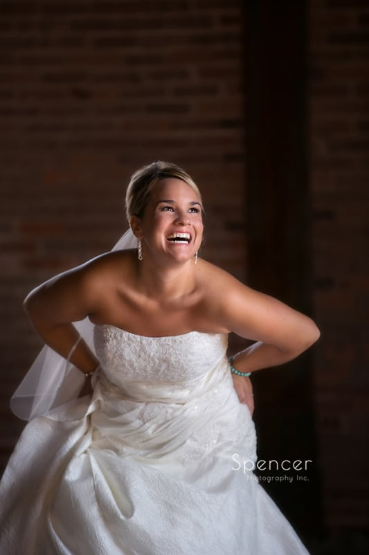 bride laughing in wedding picture in Cleveland