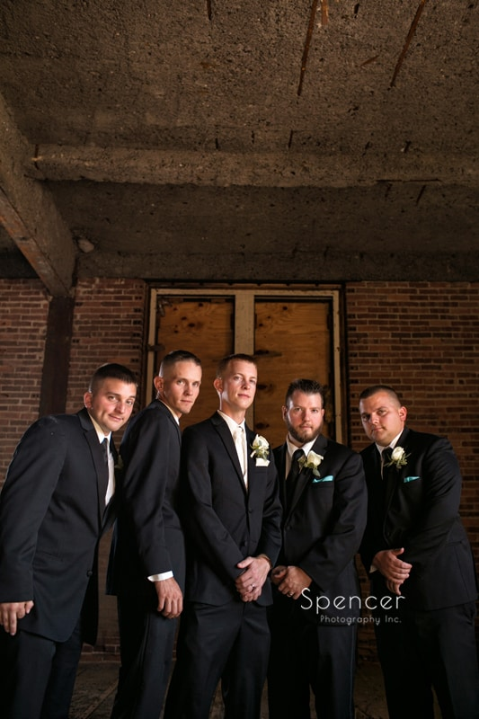 picture of groomsmen grouped in Cleveland warehouse