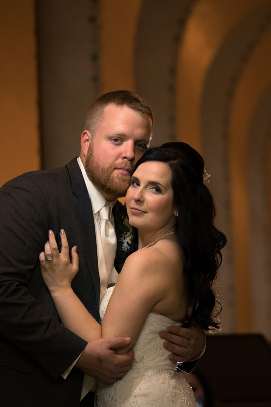 bride and groom hugging in wedding picture at Cleveland Public Library