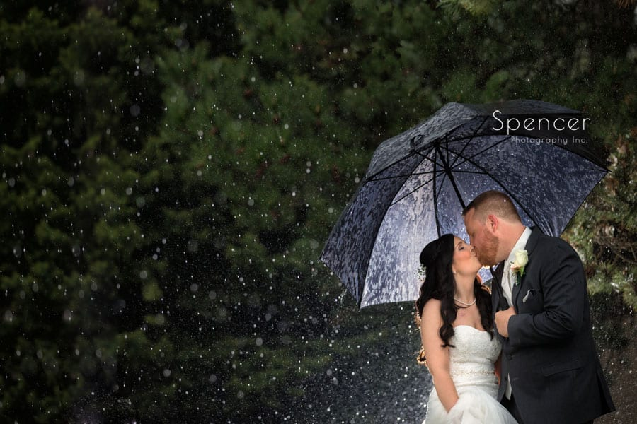 couple kissing on their rainy wedding day in cleveland