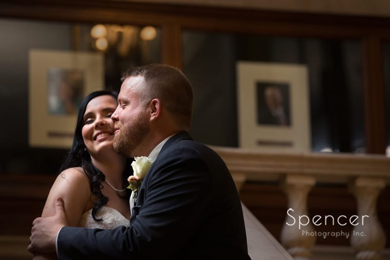 bride and groom laughing on wedding day at Cleveland Public Library