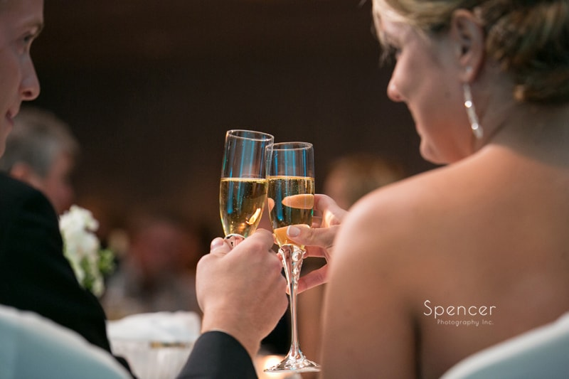 bride and groom toast at their wedding reception at LaMalfa Cleveland
