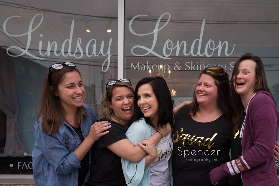 bride with bridesmaids outside lindsay london beauty