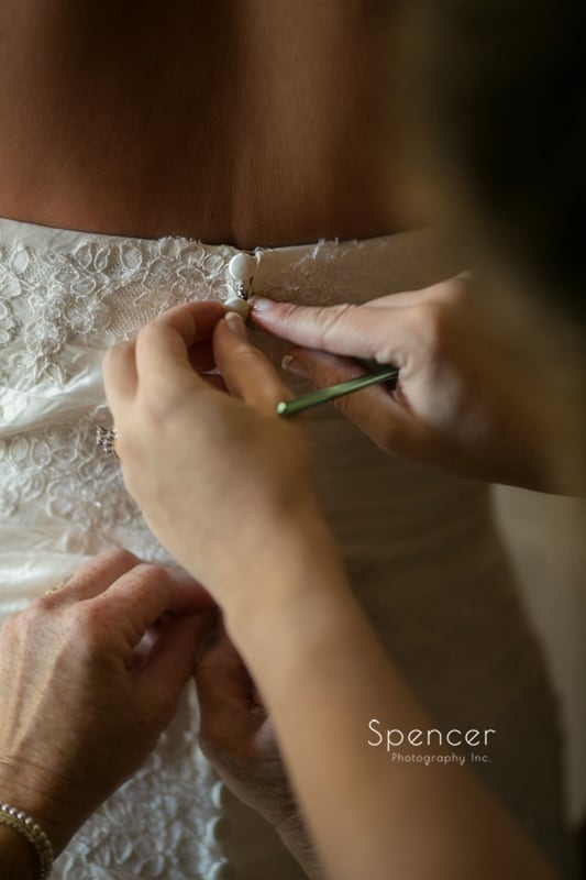 buttoning up wedding dress before cleveland wedding