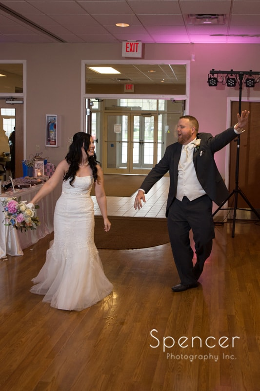 bride and groom enter their wedding reception in Perry Ohio
