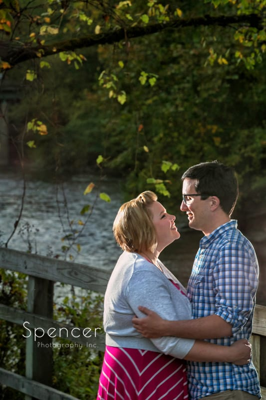 couple by cuyahoga river for their akron engagement pictures