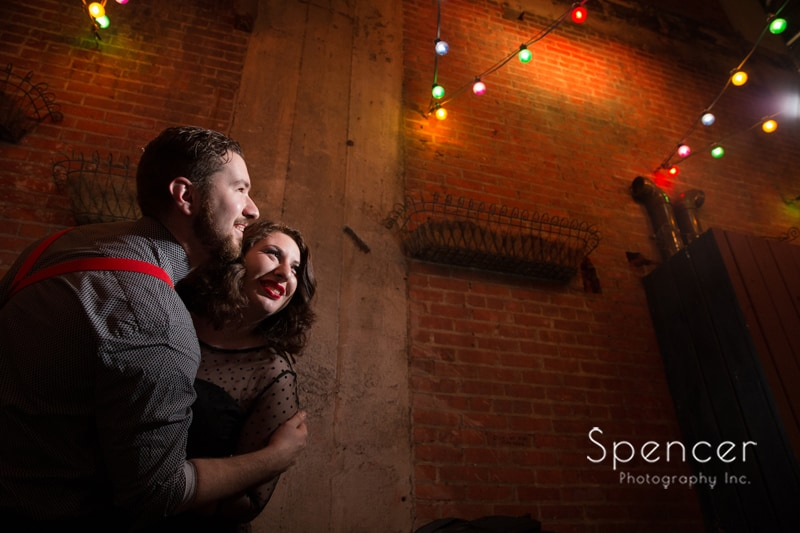 couple leaning into camera during engagement pictures in downtown Cleveland