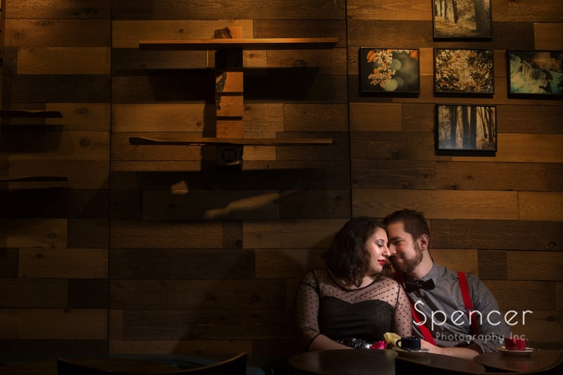 couple nose to nose during engagement session in downtown Cleveland