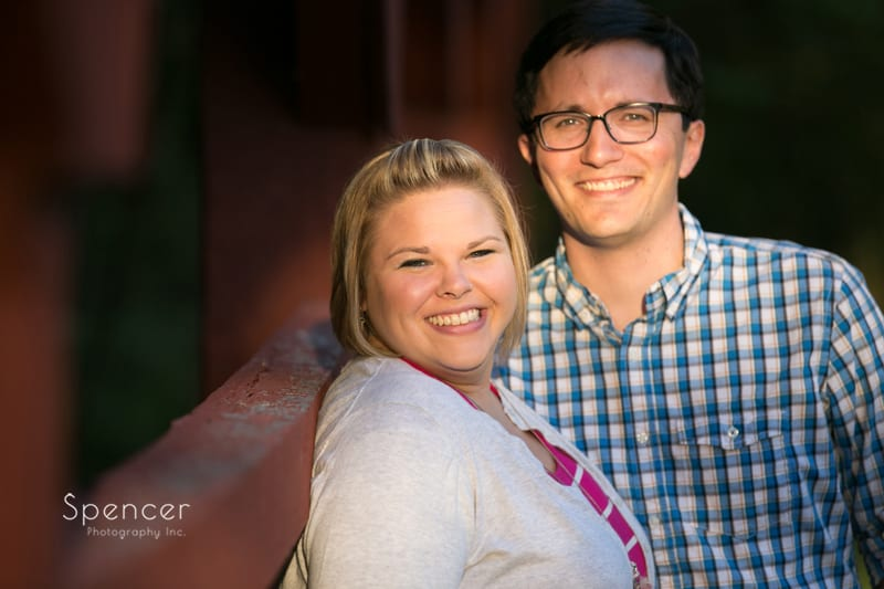 couple smiling at camera for their engagement pictures in akron ohio