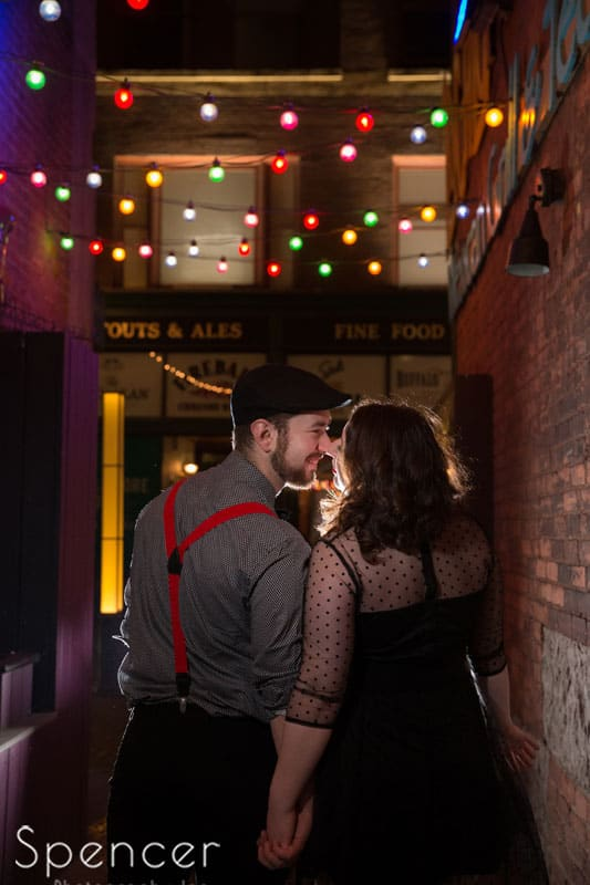 engagement picture at night in downtown Cleveland