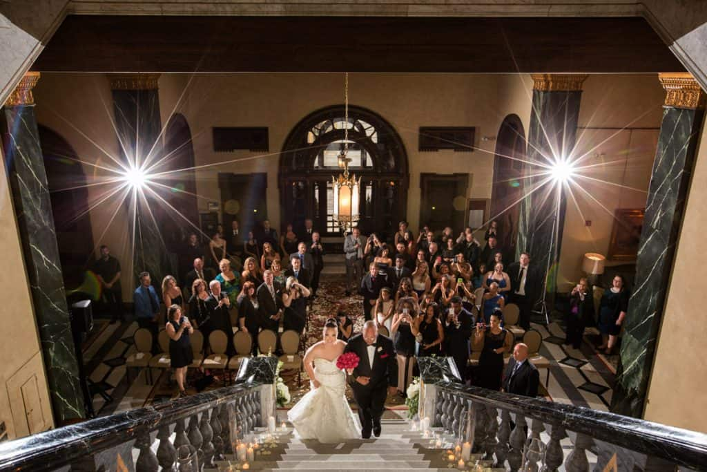 wedding ceremony on staircase of Cleveland Union Club
